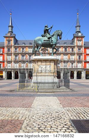 Plaza Mayor (Main Square) with statue of King Philip III (created in 1616) in Madrid, Spain