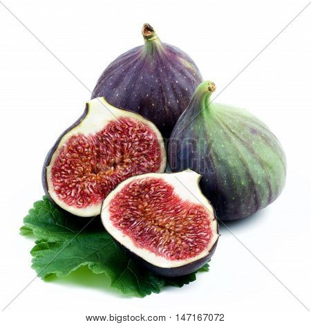 Arrangement of Fresh Ripe Figs Full Body and Halves with Leaf isolated on White background