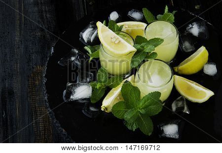 Limoncello,italian Traditional Liqueur With Lemons On The Vintage Table