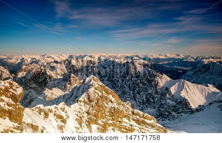 Beautiful View From Highest Mountain Peak Zugspitze Near Garmisch Partenkirchen. Cold Winter Day Wit