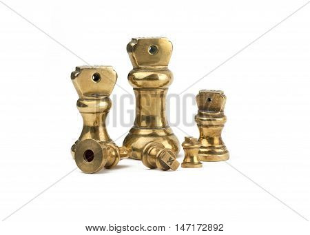 A set of antiques brass imperial weights islotated on a white background.