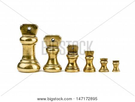 A set of antiques brass imperial weights isolated on a white background. imperial weights stood in a row