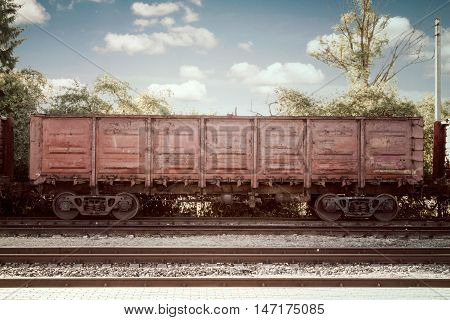 Metal cargo train container on railway at the station
