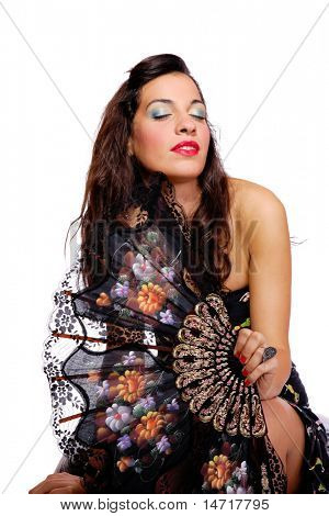 A Spanish beautiful woman behind traditional fan on white background