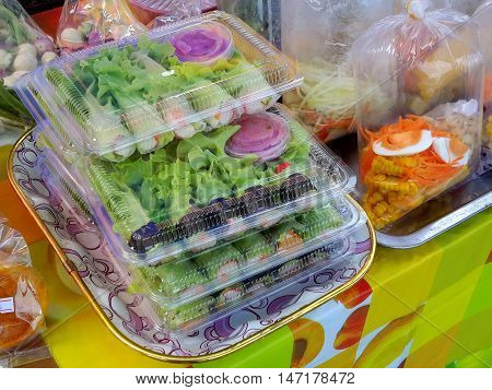 fresh homemade leafy green and egg salads for sale at a market in Ranot, Thailand