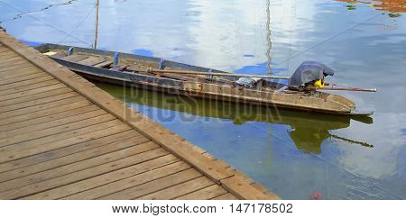 Thai longtail boat tied up at the dock, river water market at Ranot, Thailand