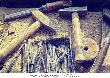 Retro Toned Old Tools On Wooden Table In Joinery.