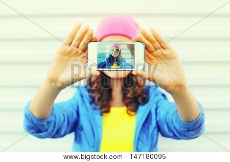 Fashion Pretty Cool Girl Taking Photo Self Portrait On Smartphone Over White Background