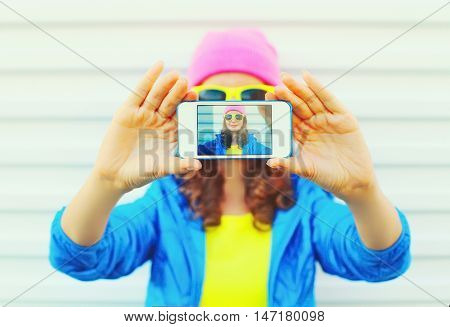 Fashion Pretty Cool Girl Taking Photo Self Portrait On Smartphone Over White Background Wearing Colo