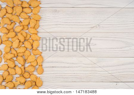 goldfish crackers on an old wooden table. Top view.