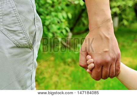 Dad holding son by the hand. Father's Day. Postcard to the Father's Day