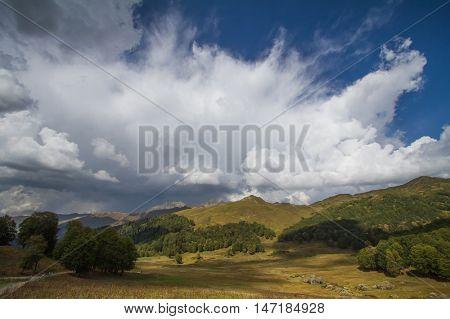 Summer mountain landscape with cumulus cloud