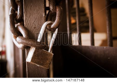old chain and key lock close door