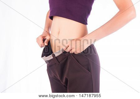 Slim waist of beauty woman in big trousersafter weight loose