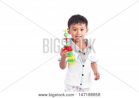 little cute boy happy play plastic toy