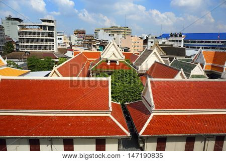 Roofs of buildings in Bangkok covered with multicolored tiles, Thailand