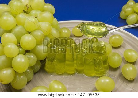 gelatin on spoon, white grape jelly, fruit dessert homemade, bunch of grapes