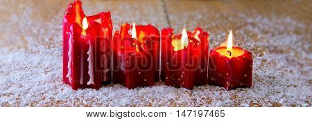 Christmas decoration with four candle for advent .Advent candles with snow.