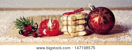 Christmas background with pastry and decoration.Christmas decoration with advent candle and red ball.