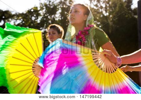 Moscow Russia - September 02 2016: Street Harinam Kirtan - the practice of chanting the holy names of God. Women in saris and with fans. Vaishnava culture. Motion blur.