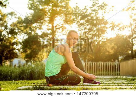 Woman Getting Ready For Training In Urban Park