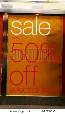Sign At Night. Sale. 50 % Off Selected Items.
