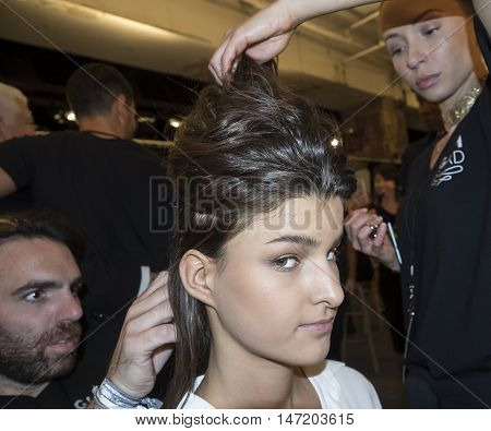 New York NY USA - September 132016: A model prepares backstage for the Dennis Basso Spring/Summer 2017 runway show during New York Fashion Week SS 2017 at The Arc Skylight at Moynihan Station