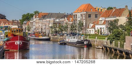 ZWOLLE, NETHERLANDS - AUGUST 31, 2016: Panorama of a canal with old ships and historical houses in Zwolle, Netherlands