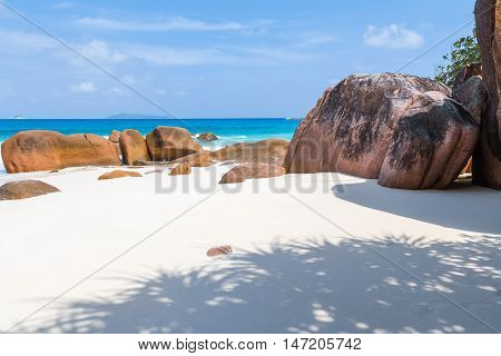 beautiful beach paradise with white sand, turquoise sea, blue sky in the Seychelles