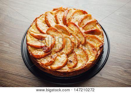 apple tart cake on wooden table top