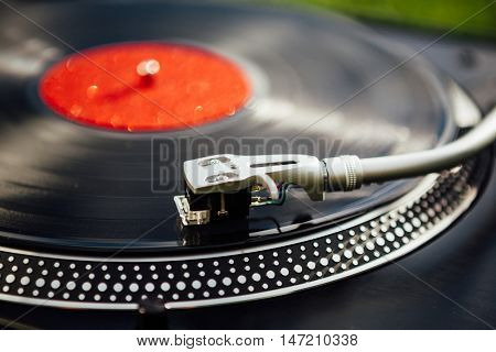 vinyl disc playing on turntable, closeup view