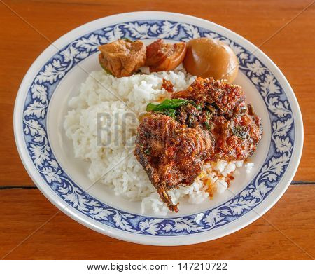 Salted eat fish with chili paste Eggs and pork in brown sauce frogs on Steamed rice