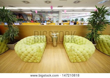 MOSCOW - JUN 03, 2015: Leather couches in rest zone of office. Tinkoff Credit Systems is first Russian bank that has completely refused from branch of bank