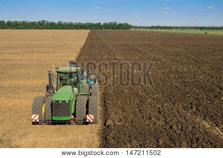 KRASNODAR REGION, RUSSIA - AUG 19, 2015: Tractor plows field, In 2015 in Krasnodar region yields reached record level - 58.4 centners per hectare