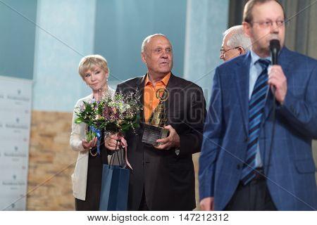 RUSSIA, MOSCOW - APR 6, 2015: Vladimir Menshov and Vera Alentova on stage award on VI online film festival Dubl dva.