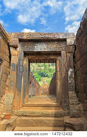 CHAMPASAK, LAOS - MAY 2015 : Laterite courtyards, walls of Northern palace's corridor at Vat Phou (Wat Phu) Khmer Hindu temple complex and UNESCO World Heritage Site in Champasak, Laos on May 25, 2015