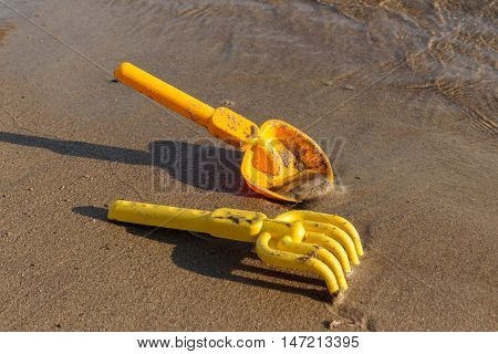 Summer Holiday, Beach, toy shovels and rakes. Outdoor recreation.