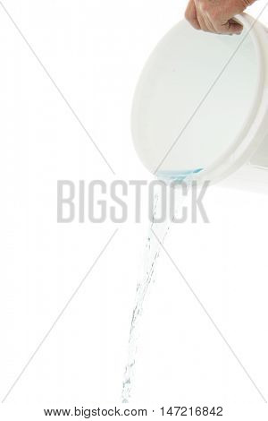 And man's hand holding a white bucket tipped to pour out water.  On a white background.