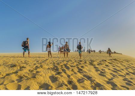 JERICOACOARA, BRAZIL, DECEMBER - 2015 - Lots of people walking towards the famous dune to see the sunset in Jericoacoara Brazil