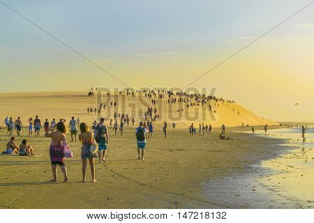 JERICOACOARA BRAZIL DECEMBER - 2015 - Lots of people walking towards the famous dune to see the sunset in Jericoacoara Brazil