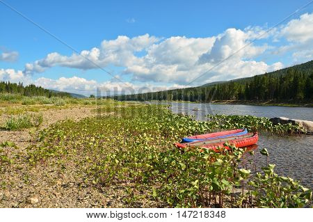 Boat trip on the river. National Park Yugid-VA UNESCO world heritage site Virgin Komi forests.