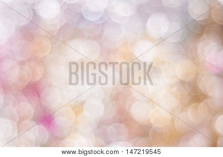 Blurred in peach and pink colors background with bokeh lights