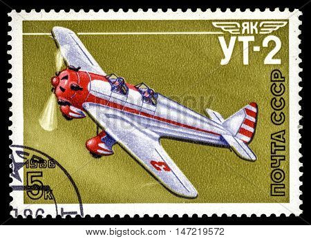 USSR - CIRCA 1986: A stamp printed in the USSR show airplane Yak UT-2 series