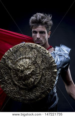 Epic, centurion or Roman warrior with iron armor, military helmet with horsehair and sword