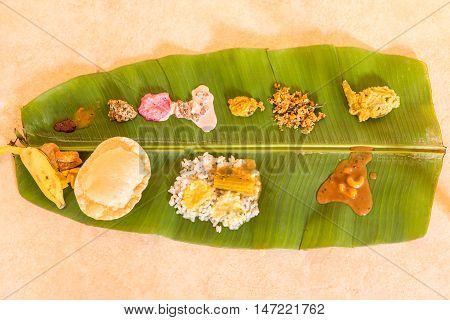 Traditional Onam Feast on banana leaf - a South Indian vegetarian meal on banana leaf served during festival seasons especially in Kerala, India