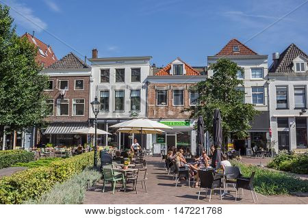 ZWOLLE, NETHERLANDS - AUGUST 31, 2016: People sittng and drinking on the main market square in Zwolle, Holland