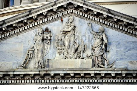 Washington DC - April 12 2014: Allegorical classical figures decorate the East front pediment of the United States Capitol building *
