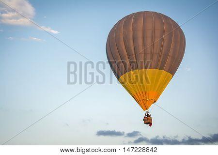 Hot air balloon in a blue hour sky