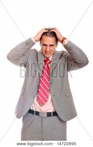 Portrait of a young business man screaming against white , suffering from a bad headache