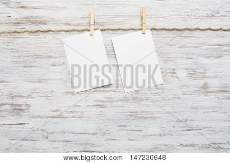 Blank paper sheet for text hanging on rope
